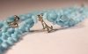 Two pale blue laces with Dog Charms Chachal